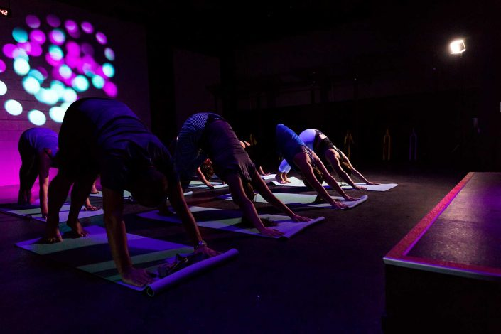 Image of people on yoga mats at the 1U Unwind Yoga Class Beachlands