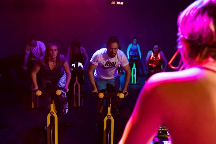 Peopl in a high intensity spin class at ALLFIT 24/7 Fitness Gym Beachlands